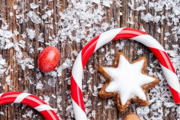 Festive Christmas wooden background with sweets and decoration